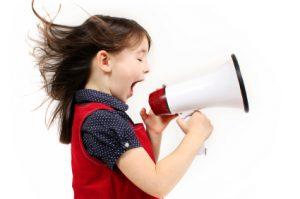 girl-shouting-into-loadhailer