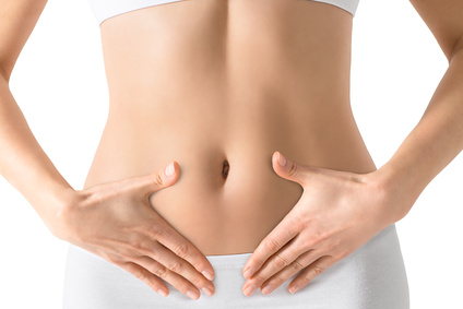 Woman holding hands on a belly. Stomach health concept. Isolated